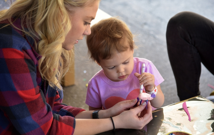 Church Street's teaching artists helped out in the crafts tent. Photo: Carl Glassman/Tribeca Trib