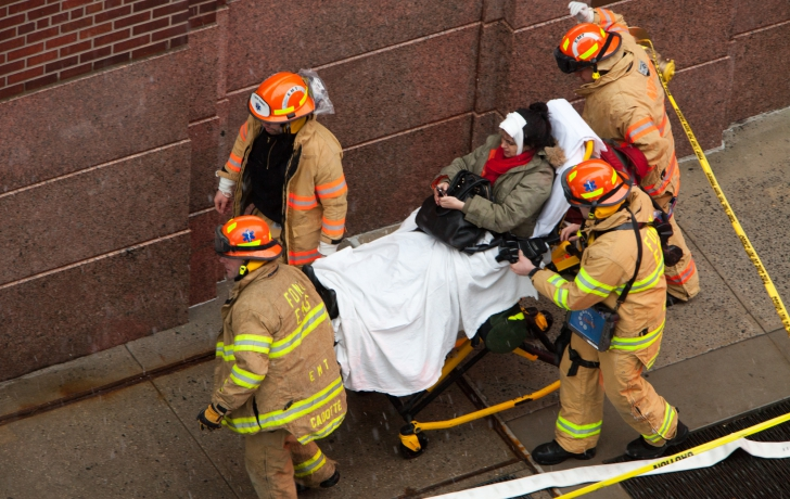 An injured person is removed from the scene. Photo: Allan Tannenbaum