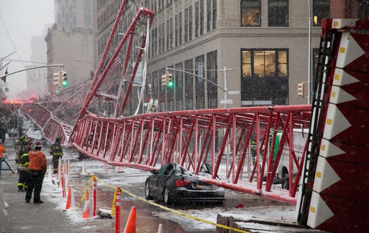 On Friday, the fallen crane crushed several parked cars when it fell along Worth Street. Photo: Allan Tannenbaum