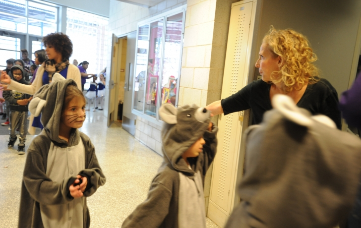 """Susan Kay, the director and """"hub"""" of the annual  helps get kids up the stairs. Photo: Carl Glassman/Tribeca Trib"""