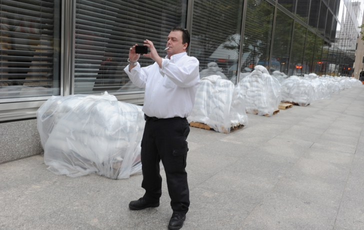 Bundles of sandbags lay beside the Goldman Sachs building Sunday afternoon, waiting to be positioned behind  concrete barriers along Vesey Street. Carl Glassman/Tribeca Trib