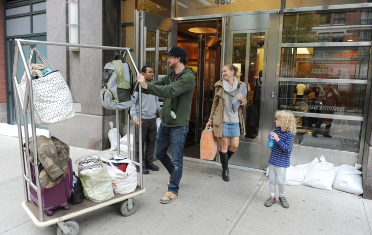 Erin Sumwalt and Johnny Boose, with Hudson, leave their building at 450 North End Ave. Carl Glassman/Tribeca Trib