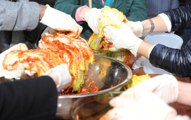Plastic gloves are used during preparation because chili peppers and salt can irritate skin.