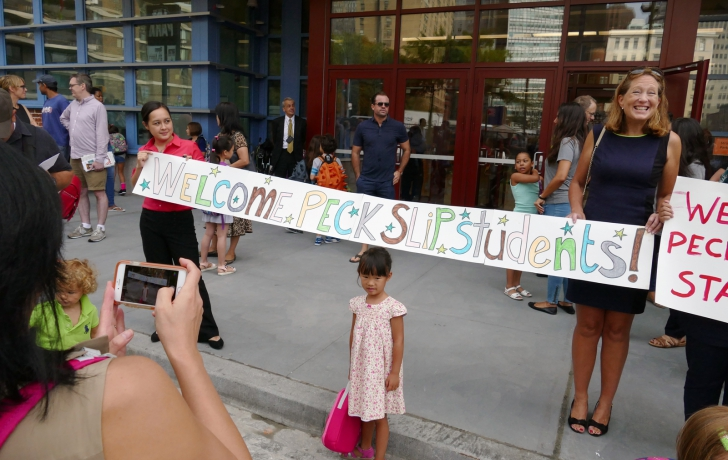 Also getting her picture taken is kindergartner Violet Kuan by her mother, Julia. Behind Violet, welcoming the children, are Community Board 1 Chair Catherine McVay Hughes, right, and Yume KItasei, Councilwoman Margaret Chin's chief of staff. Photo: Carl Glassman/Tribeca Trib