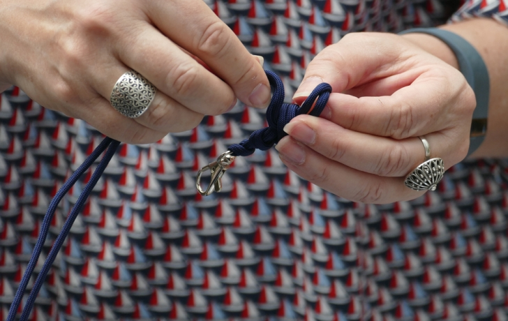 Activities included nautical-themed knot-tying for key chains, above, and bracelets. Visitors could learn a variety of knots, including the granny, double fisherman's bend and plain old square. Photo: Carl Glassman/Tribeca Trib