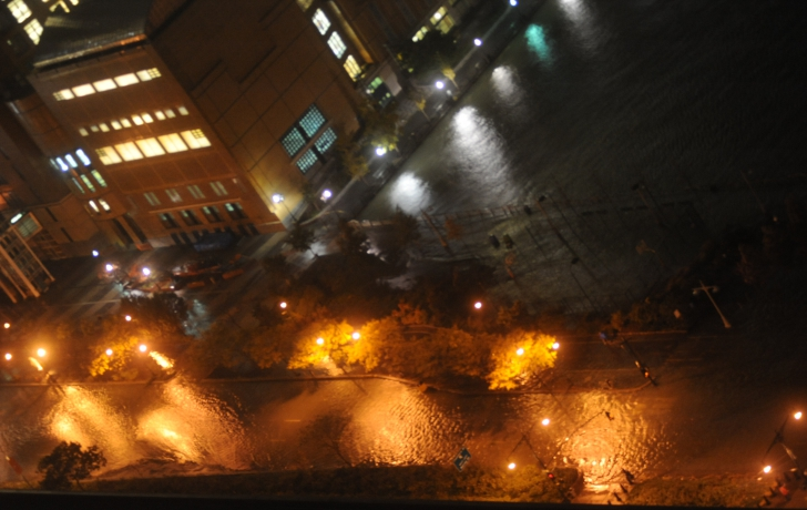 The Hudson River floods into West Street on Monday night.