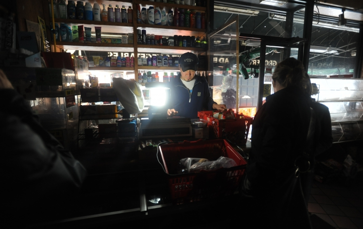Customers shop in the dark in Tribeca at Morgan's Market.