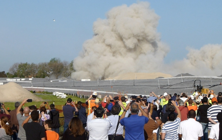 Spectators cheered the implosion of a building on Governors Island that formerly housed Coast Guard families. Photo: Carl Glassman/Tribeca Trib