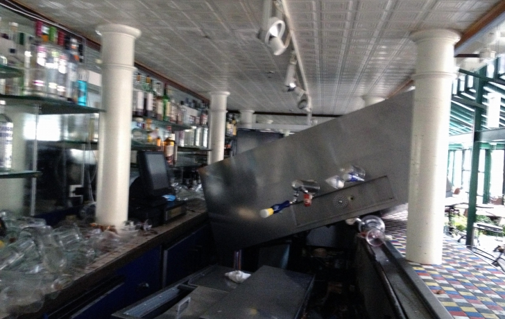 "A beer fridge that too ""five people"" to move into place, was lifted by the flood waters and landed atop the bar inside Il Porto on Fulton Street."